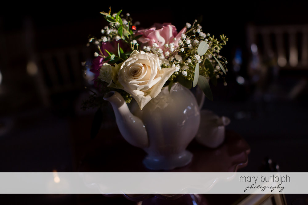 Wedding bouquet in a teapot at The Lodge at Welch Allyn Wedding