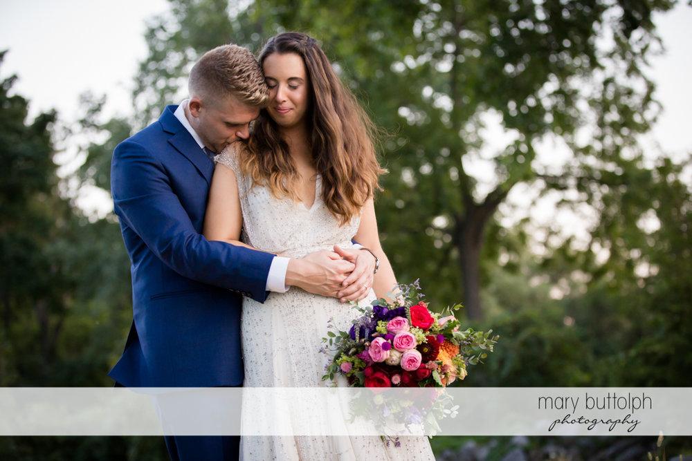 Couple share a quiet moment in the garden at Aurora Inn Wedding