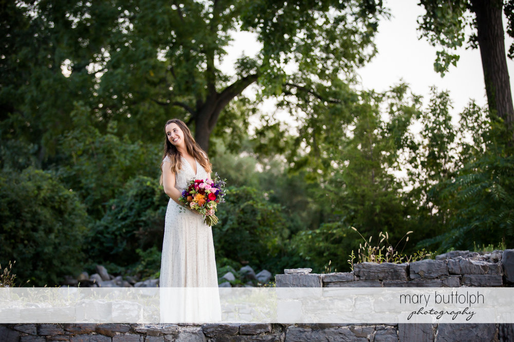 Bride poses for posterity at Aurora Inn Wedding
