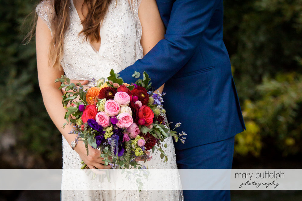 Flowers are the focus of this shot at Aurora Inn Wedding