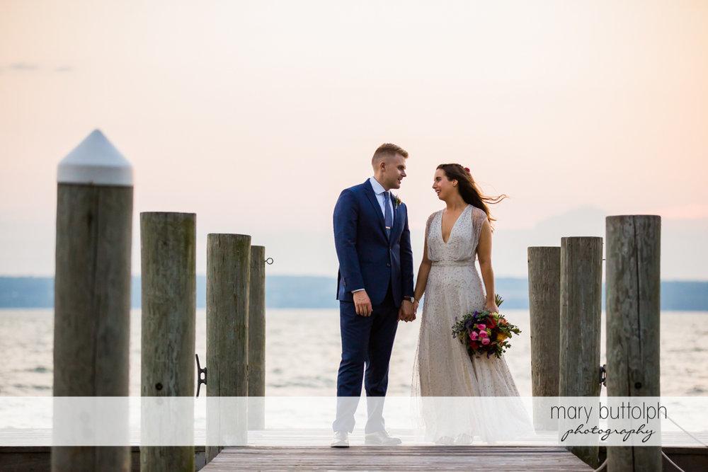Couple pose near the lake at Aurora Inn Wedding