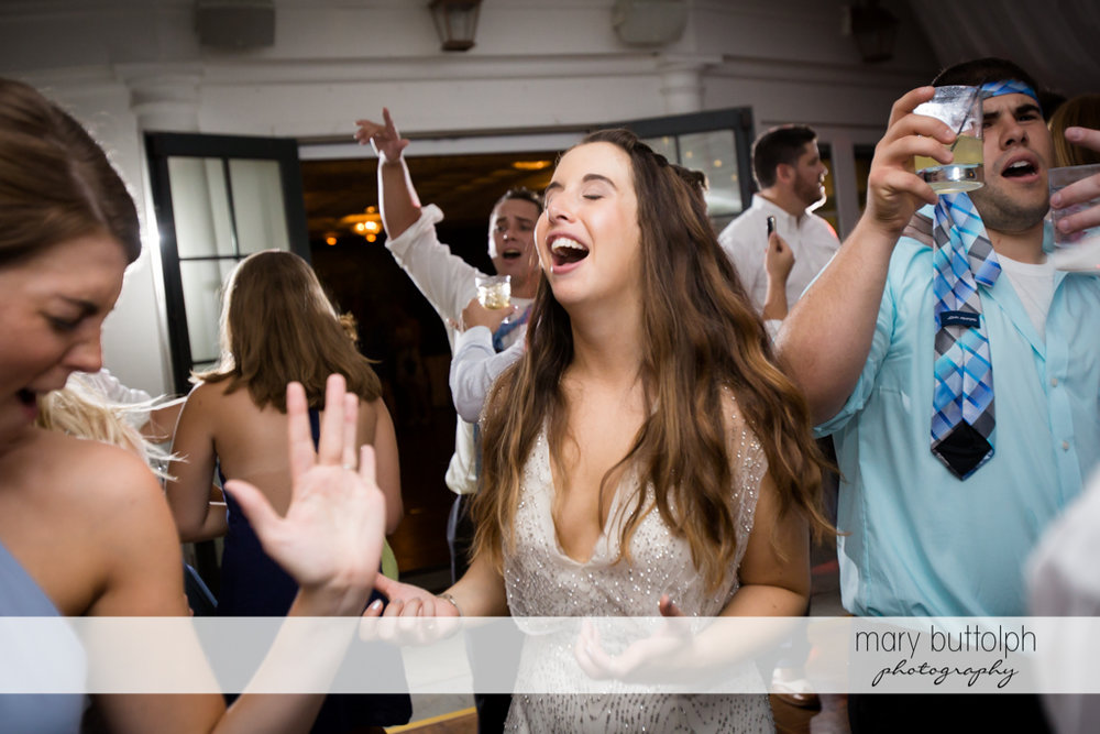 Bride parties with guests at Aurora Inn Wedding