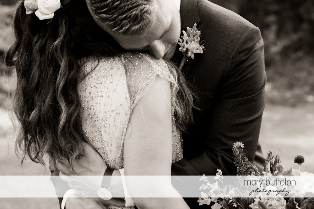 Couple embrace in a dramatic black and white shot at Aurora Inn Wedding