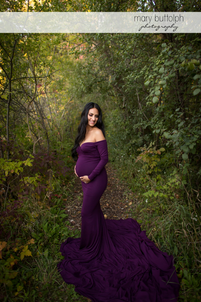 Woman enjoying her pregnancy in the woods at Skaneateles Maternity Photography