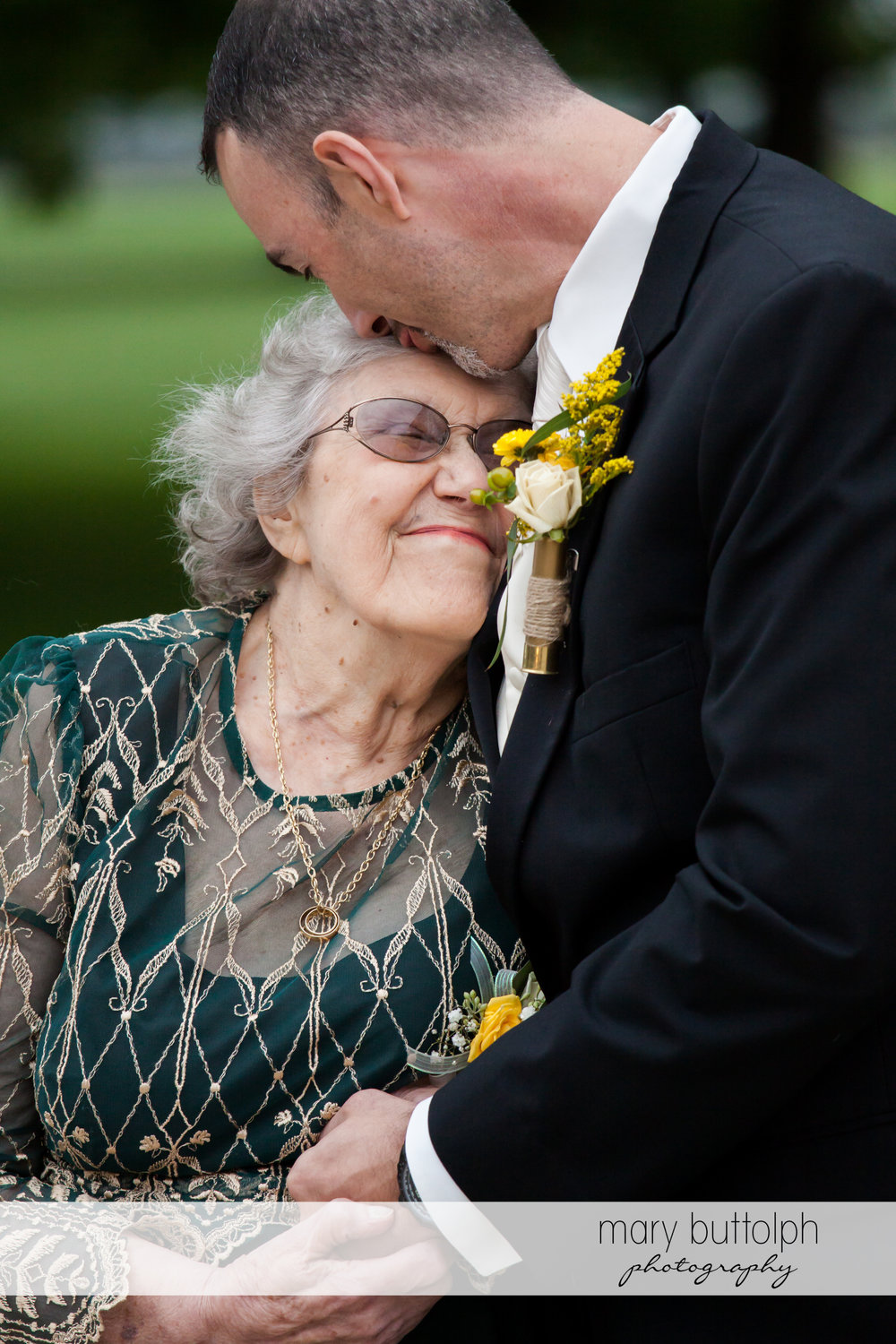 Groom hugs his mom at Emerson Park Pavilion Wedding