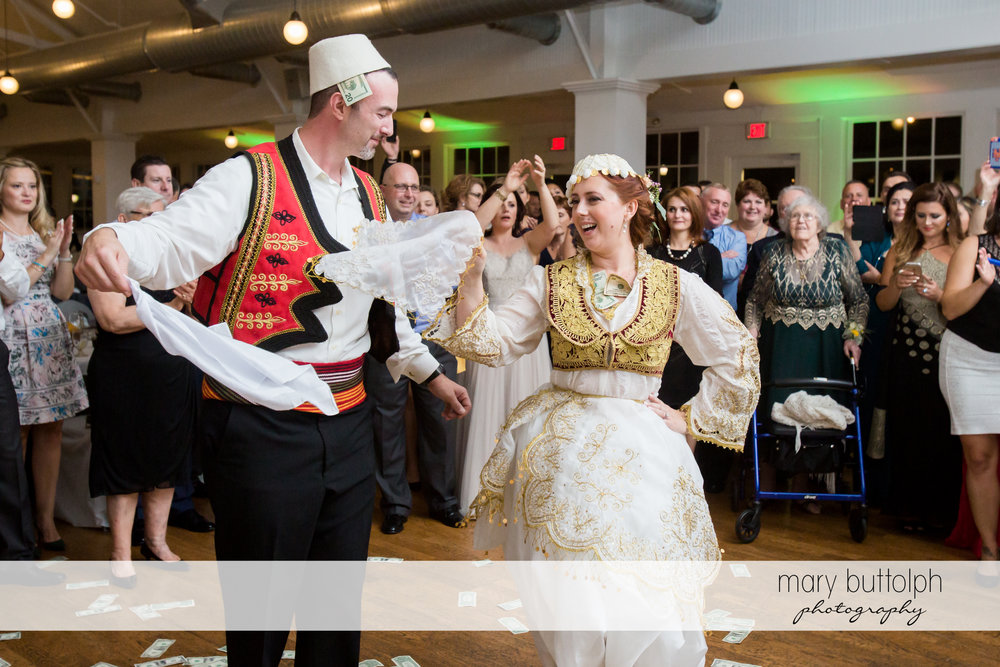 Couple dressed in traditional Albanian garb dance at Emerson Park Pavilion Wedding