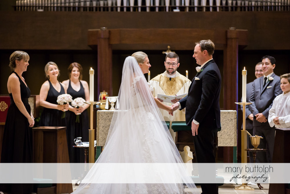 Couple in wedding ceremony in front of a priest at SKY Armory Wedding