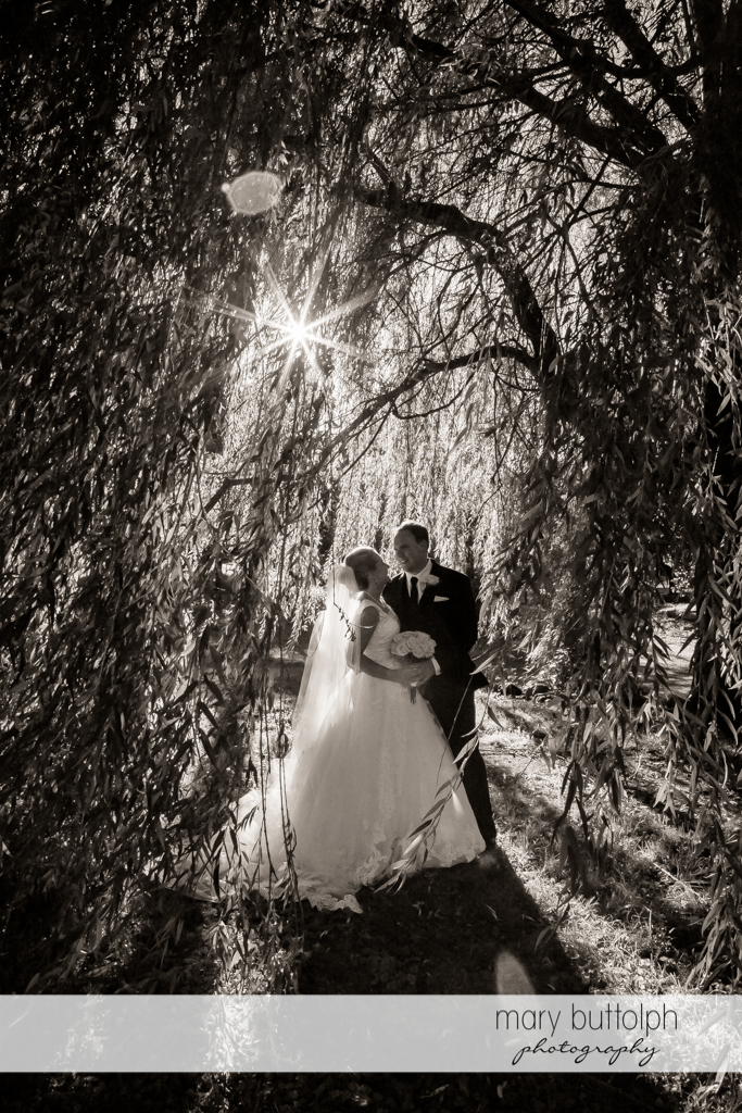Couple catch the sunset in the park at SKY Armory Wedding