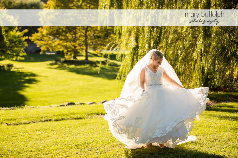 Bride displays her wedding dress in the park at SKY Armory Wedding