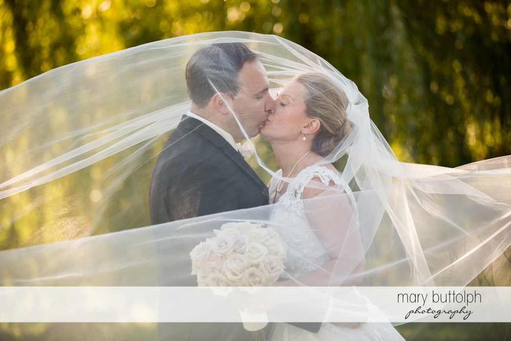 Couple express their love in the park at SKY Armory Wedding