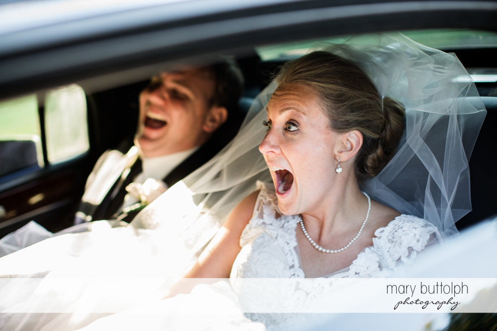 Couple share a laugh in the bridal car at SKY Armory Wedding