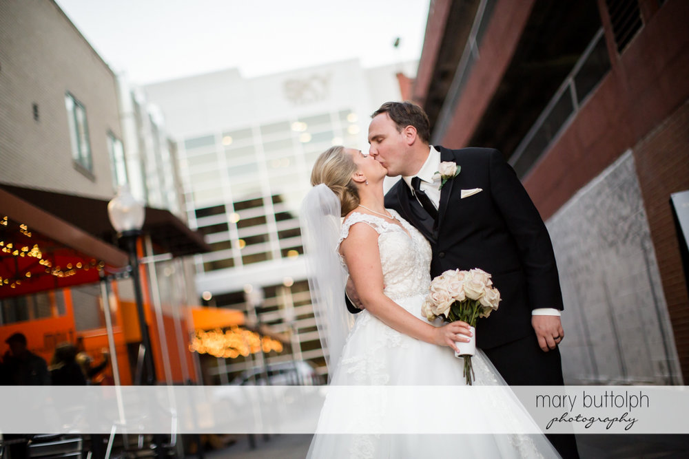 Couple kiss at the wedding reception at SKY Armory Wedding