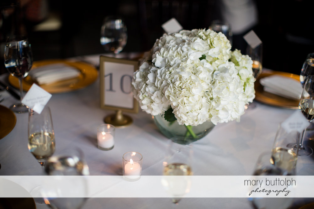 Flowers decorate the table at the wedding reception at SKY Armory Wedding