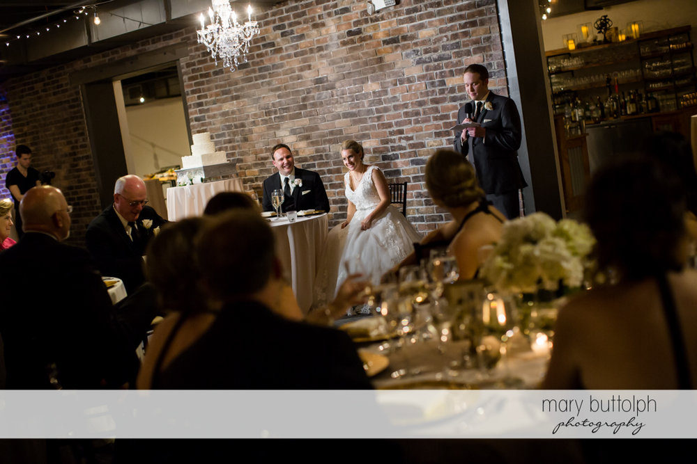 Couple at wedding reception in front of guests at SKY Armory Wedding