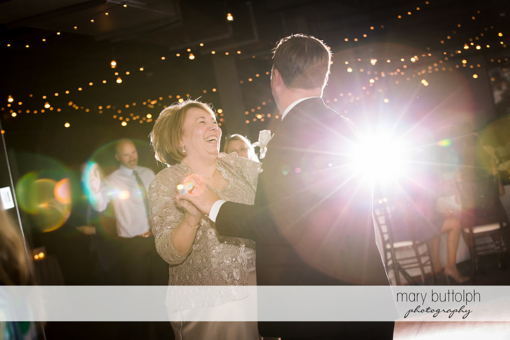 Groom dances with a guest at SKY Armory Wedding