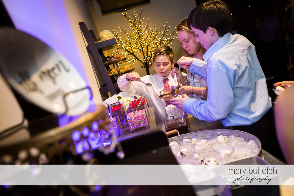Couple's young guests help themselves to dessert at SKY Armory Wedding