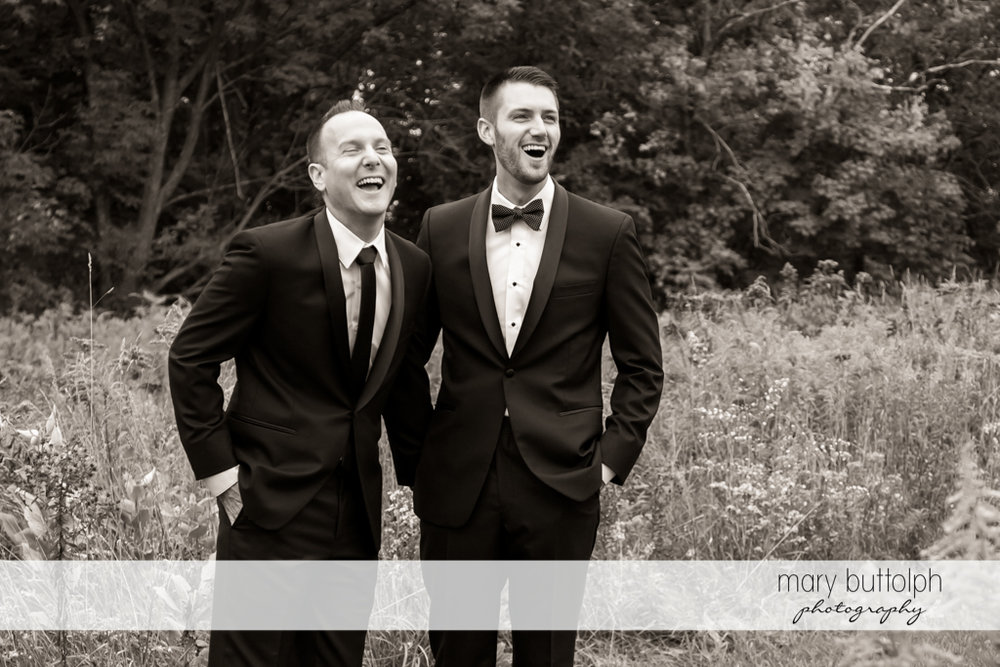 Same sex couple laughing in the garden at Anyela's Vineyards Wedding