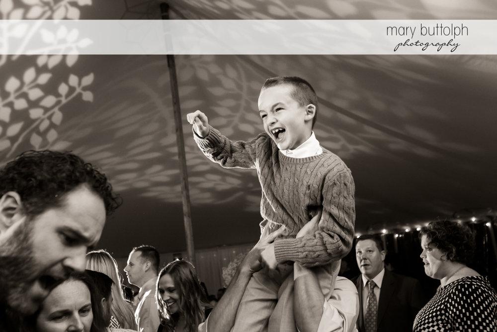 Young guest having a ball at same sex couple marriage at Anyela's Vineyards Wedding