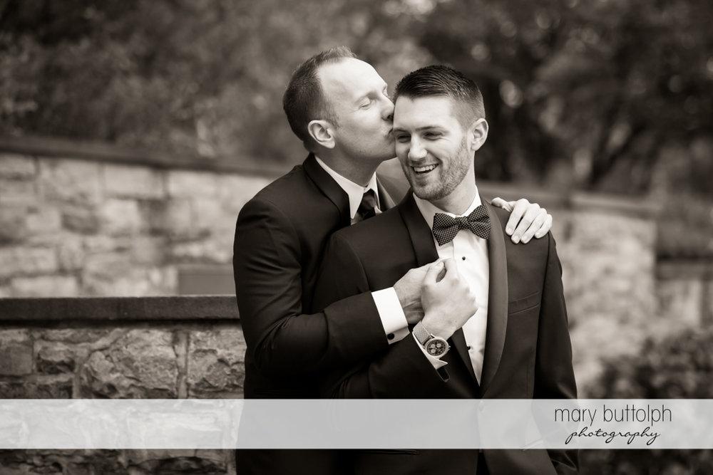 Same sex couple pose for posterity at Anyela's Vineyards Wedding