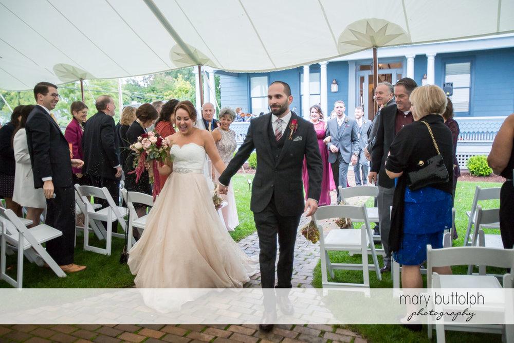 Bride and groom walk the aisle at Sherwood Inn Wedding