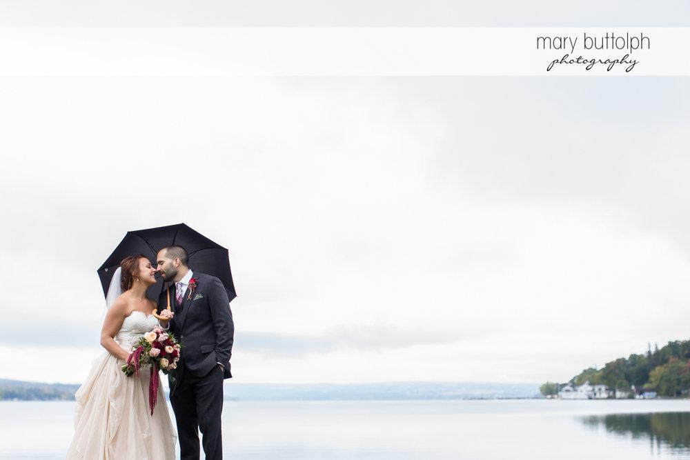 Couple share umbrella at Sherwood Inn Wedding