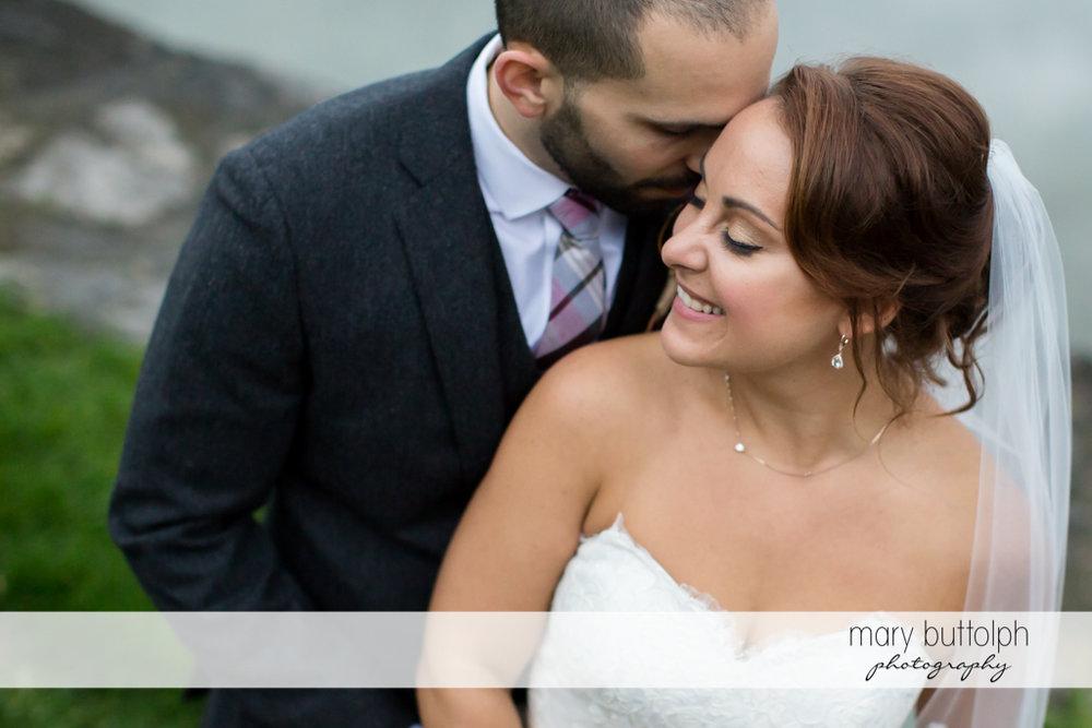Groom whispers to bride at Sherwood Inn Wedding
