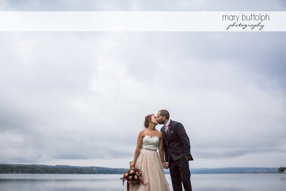 Couple kiss by the lake at Sherwood Inn Wedding
