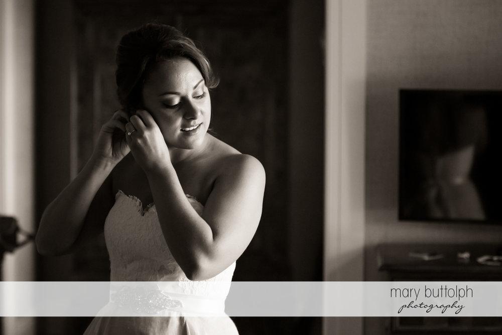 Bride fixing her hair at Sherwood Inn Wedding