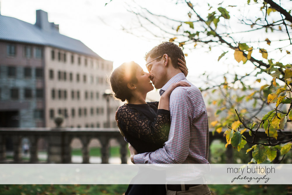 Couple kiss each other at Cornell University Engagement