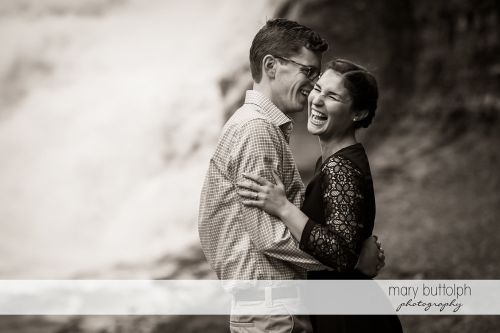 Couple locked together in warm embrace at Cornell University Engagement