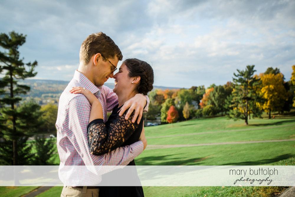 Couple rub noses at Cornell University Engagement