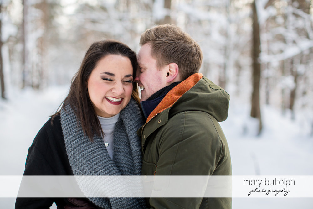 Couple share a light moment at Highland Forest Engagement