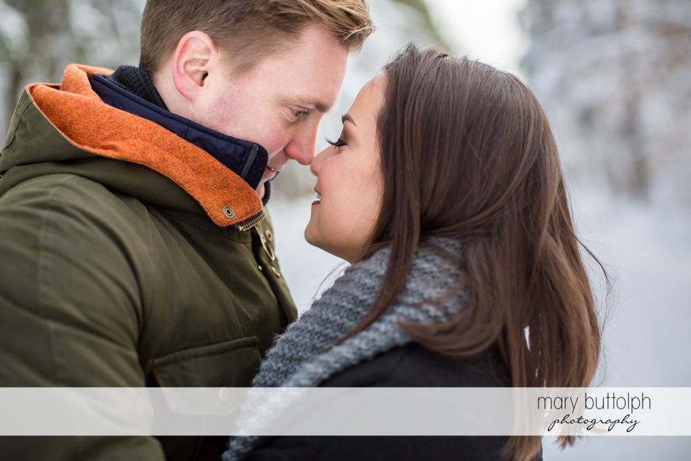 Couple rub noses at Highland Forest Engagement