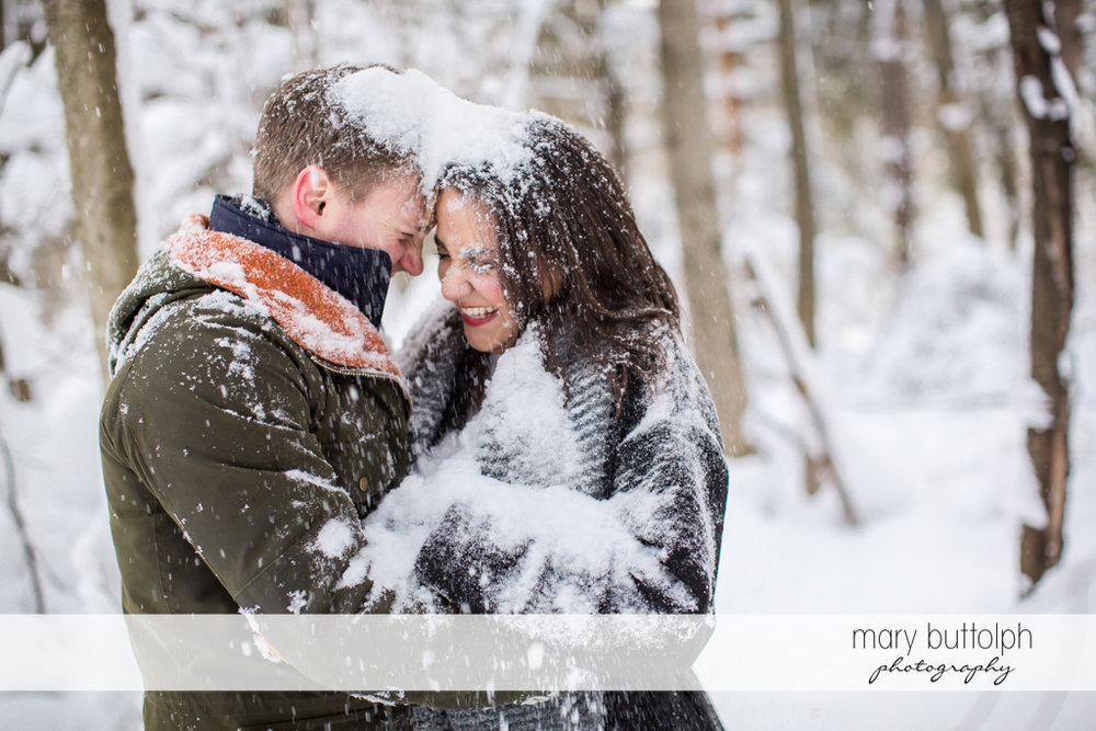 Couple covered in snow at Highland Forest Engagement
