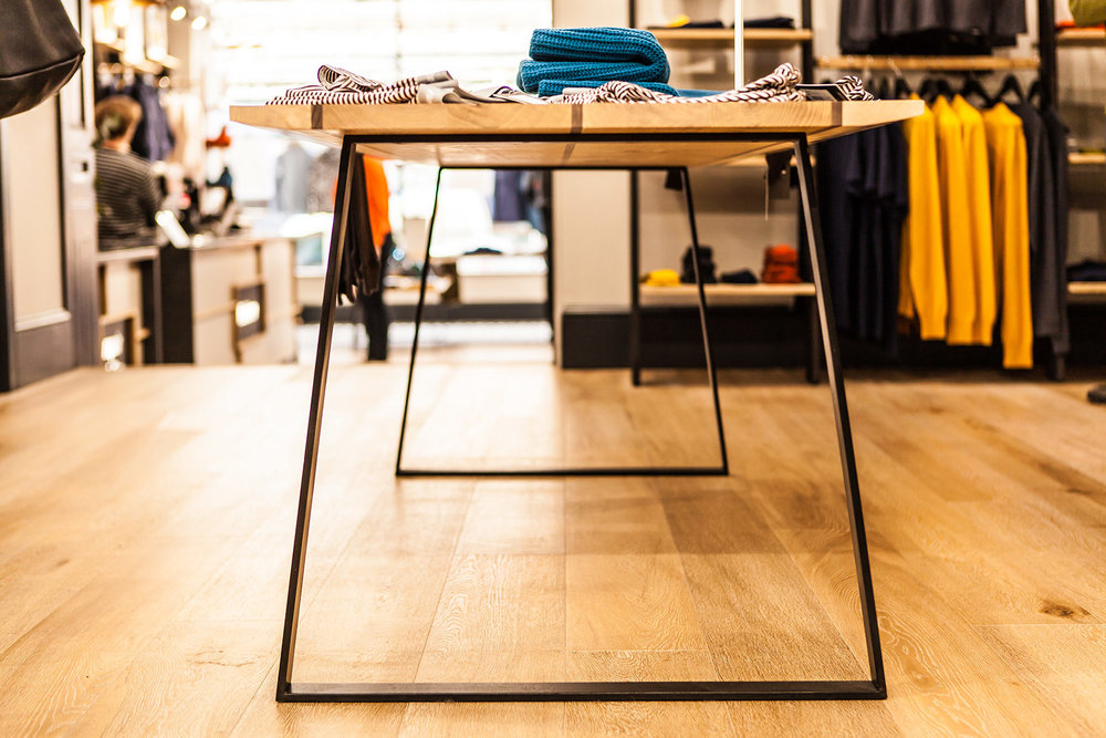Finisterre Bristol store: Japanese-inspired European oak, black walnut and sycamore table with steel legs by  Alex Accleton    → fine woodwork, 2016