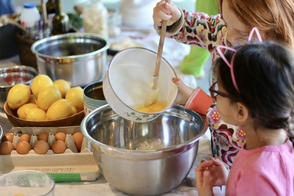 Adding eggs to the flour for pasta dough.  Photo by Laura Kirkpatrick