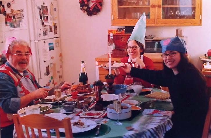 Christmas 2002 at home: Dad, me, my sister and Mom (behind the camera). A festive table complete with champagne.