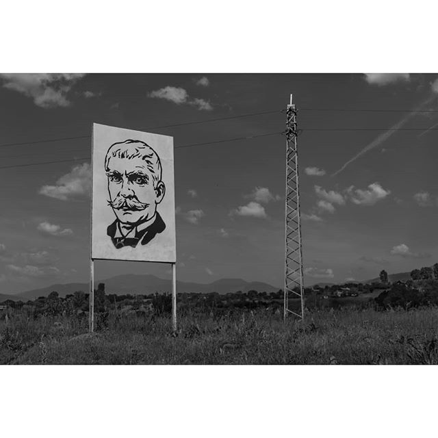 Ivan Vazov stares down from a billboard in #Bulgaria.  #IvanVazov is considered the father of Bulgarian literature and his face appears on buildings and monuments across the country.  #EU #Europe #EuropeanUnion #documentary #documentaryphotography #travelphotography #travelphoto #travel #landscape #landscapephotography #street #streetphotography #blackandwhite #bnw #blancoynegro #nikon #Digital #lensculture