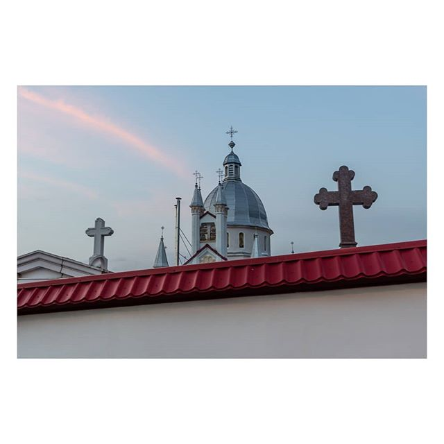 The dome of a #church rises above a wall in central Romania.  #Romania is the #EU's second most #religious country after #Malta, with an estimated 92% of the population believing in #God.  #Europe #EuropeanUnion #documentary #documentaryphotography #travelphotography #travelphoto #travel #urban #urbanphotography #street #streetphotography #colour #colourphotography #Nikon #Digital #irimages @lensculture