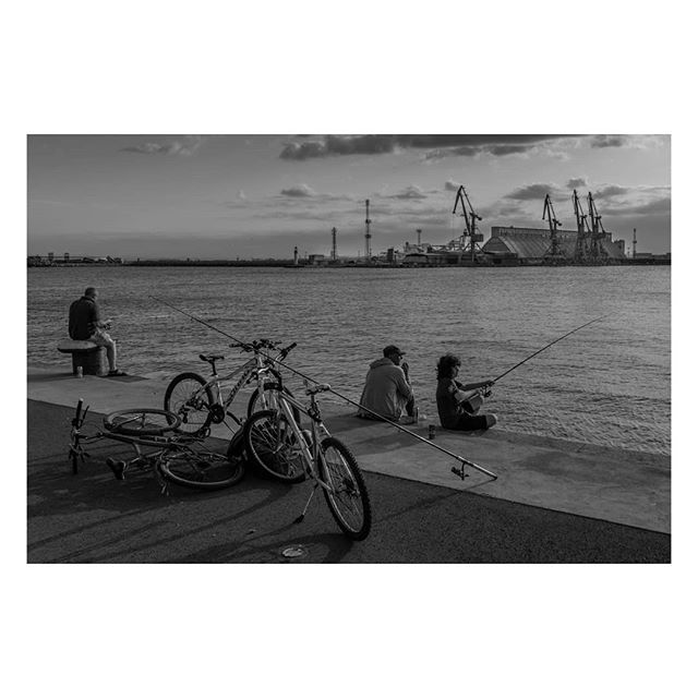People #fishing in the harbour at #Burgas on the #BlackSea.  #Bulgaria #България #EU #Europe #Бургас #documentary #documentaryphotography #Travel #travelphotography #travelphoto #blackandwhite #bnw #bnw_life #bnwphotography #bnw_captures #street #streetphotography #ourstreets #Nikon