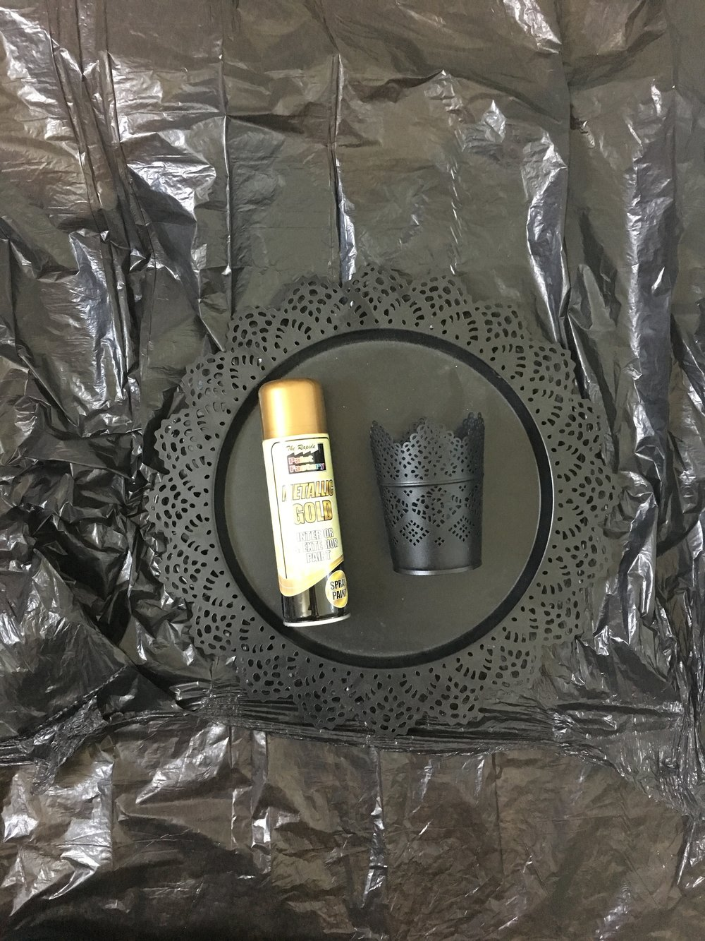 use metallic gold spray paint - spray at a safe distance of (i dunno) and spray evenly over the surface - i mean its not rocket science!