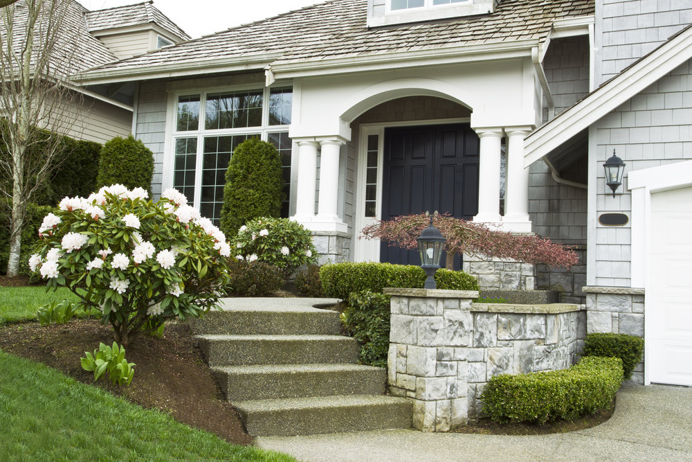 Create a Grand Entrance with Natural Stone Pillars and Walls in Lanoka Harbor, NJ