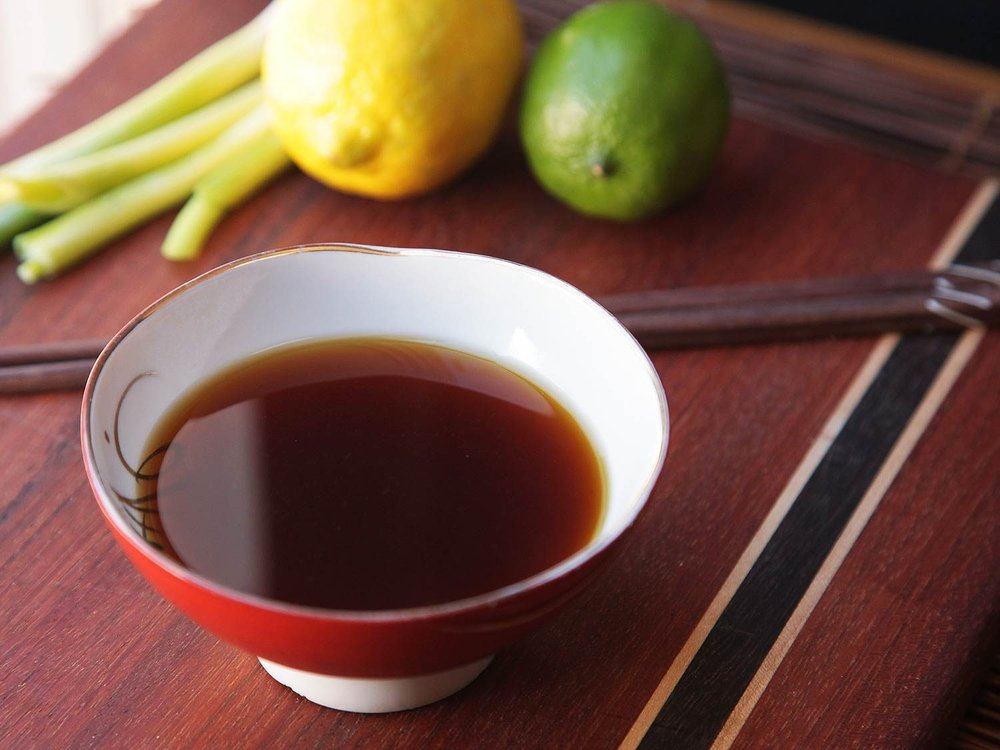 Ponzu: a citrus-based sauce commonly used in Japanese cuisine. It is tart, with a thin, watery consistency and a dark brown color.