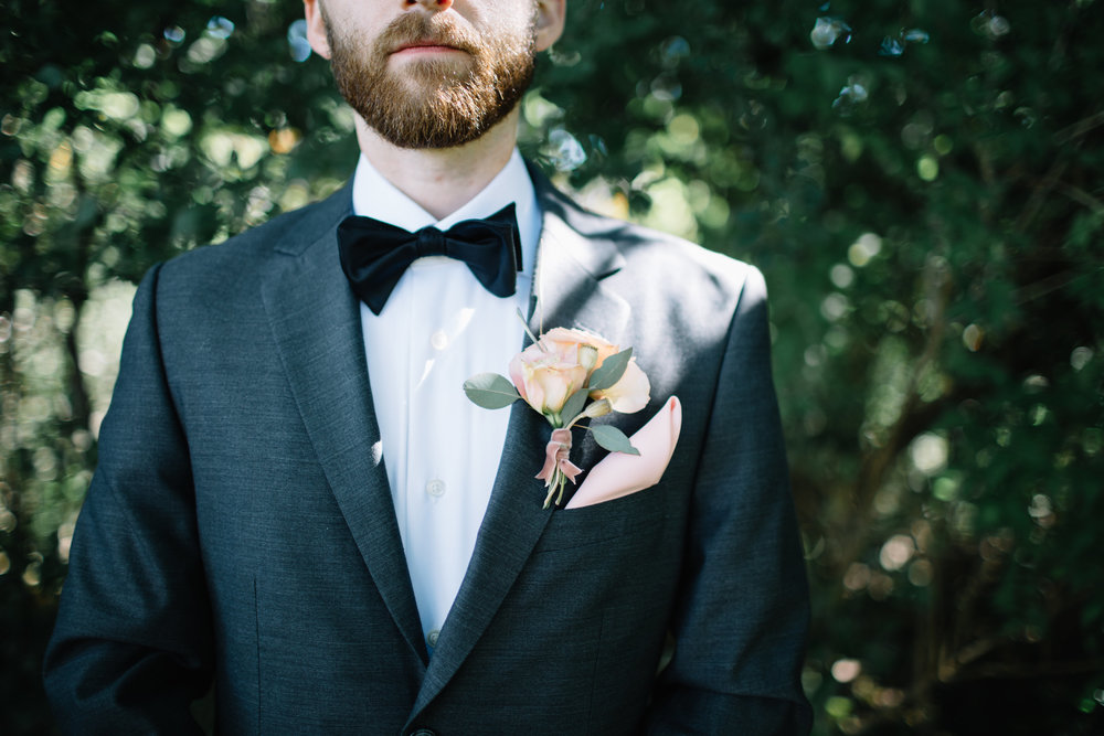 "Specified shot on our shot list: ""closeup of Jon's bow tie/boutonniere"""