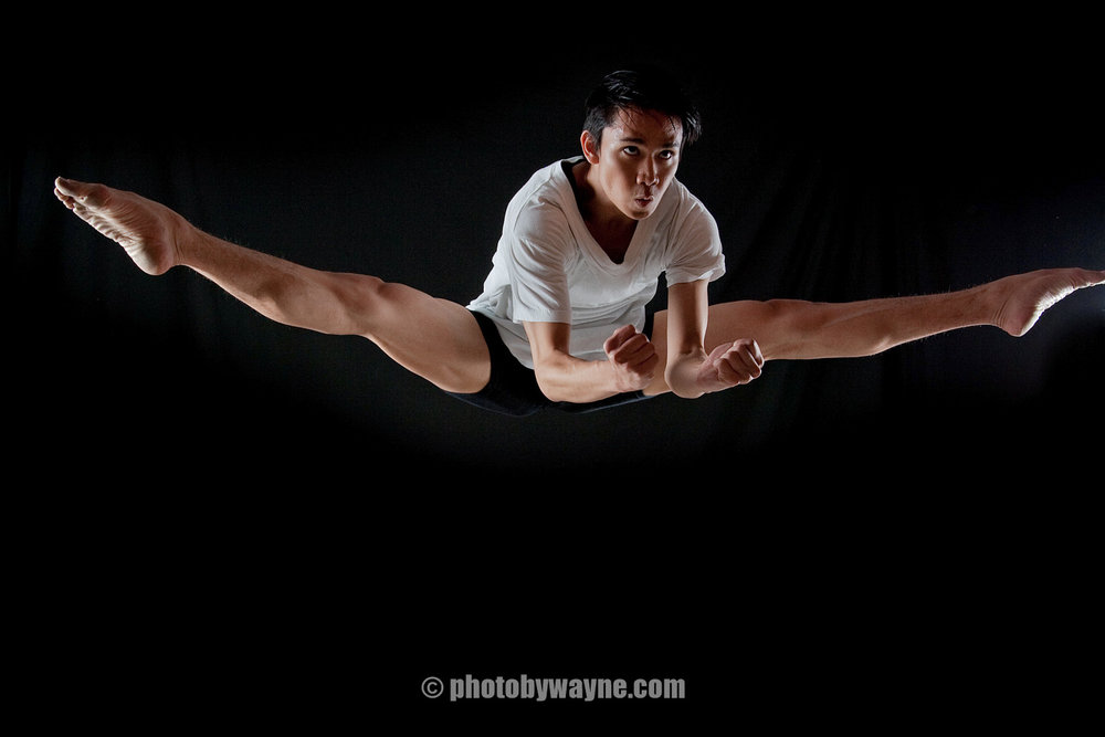 male dancer split mid air