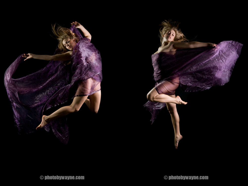 girl-jumping-up-with-purple-farbic.jpg