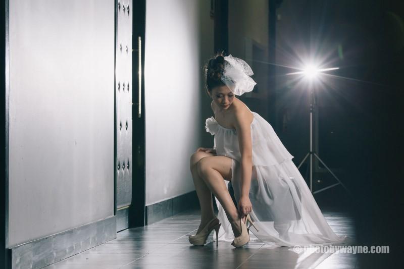 bride fixing her heels
