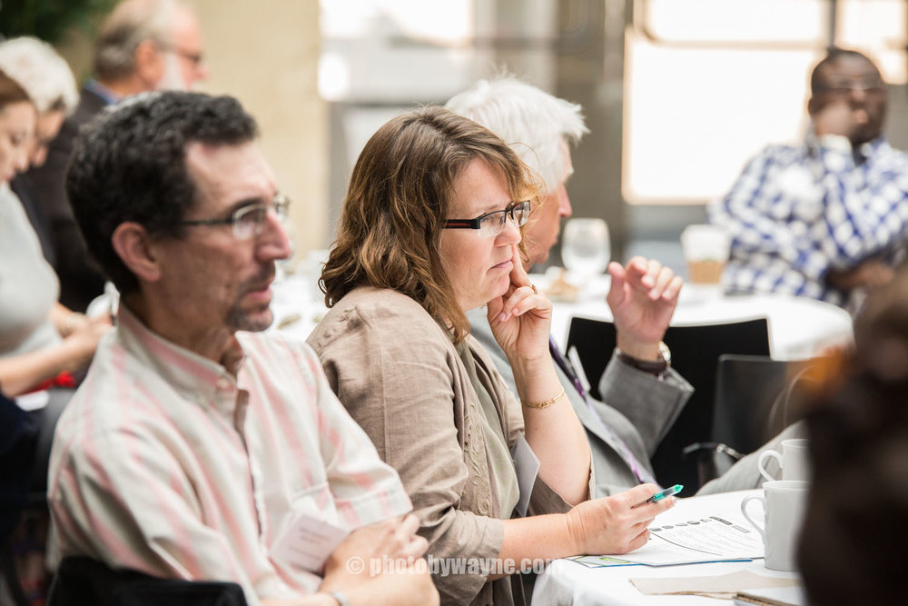 conference-attendees-listening-to-presentations.jpg