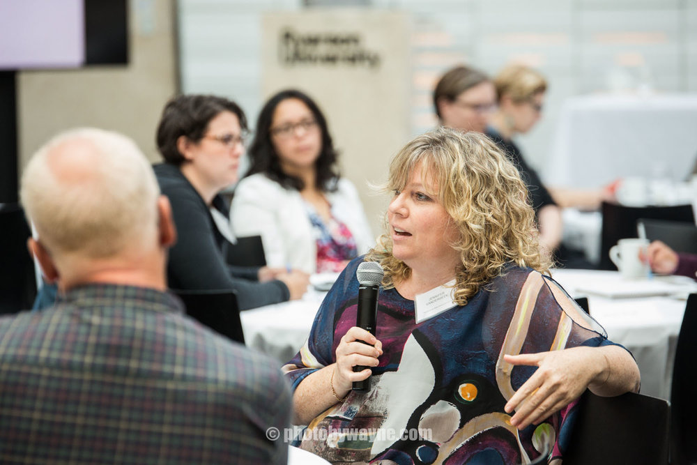 woman-asking-a-question-at-a-business-conference-in-toronto.jpg