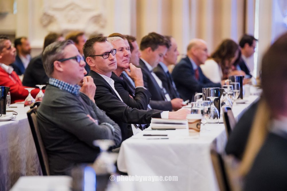 business-conference-attendees-listening-to-presentation.jpg